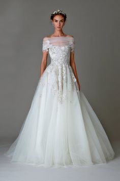 This Marchesa wedding gown has stunning intricate floral embellishments