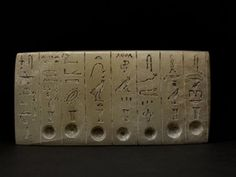 Rectangular limestone tablet; eight columns of incised Hieroglyphic text; seven oil-wells: equipment for Opening-of-Mouth ceremony.
