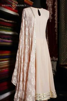 Understated elegance in this peach-ivory anarkali. #indian #wedding