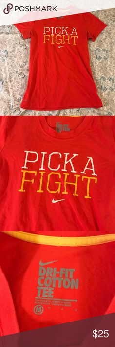 """Nike Red Livestrong """"Pick A Fight"""" Tee Shirt Bright and fun Nike Dri-Fit cotton tee shirt! Bright red color with """"Pick A Fight"""" in white and yellow above the Nike logo, with a Livestrong tag on side. Worn only a few times, in great condition! Nike Tops Tees - Short Sleeve"""