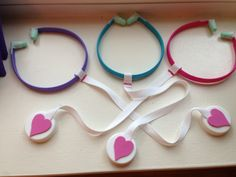 Headband stethoscopes were a big hit! - I used medical tape to attach foam ear plugs, sewed cotton webbing ribbon in a loop to go around the headband, juice bottle lids for the disks and foam hearts. Tip: use the hot glue gun to attach the disks.