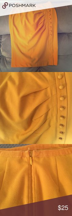 Yellow/gold high waisted long skirt New York and Co. yellow/gold high waisted pencil skirt. Skirt hits just below the knee/at the knee. Small slit bottom left. Like new condition. New York & Company Skirts Pencil