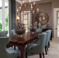 Gorgeous chairs! Choose a rich color, not cream or white.  Also a nice idea for two matching centerpieces offset by the chandelier.