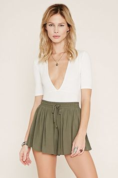 Forever 21 High Waisted Flowy Shorts Adorable woven high waisted olive green shorts from Forever Drawstring tie waist that is elasticized. Approximately inches long. Size medium and brand new with tags! Short Outfits, Short Dresses, Summer Outfits, Summer Clothes, Flowy Shorts, High Waisted Shorts, Silk Shorts, Cute Maternity Shirts, Olive Green Shorts