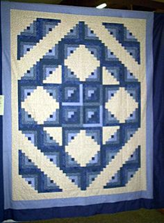 I want to make a king-size teal and yellow log cabin quilt with red centers.
