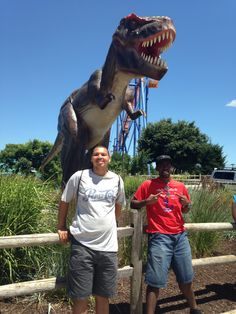 On July 5, My best friend, Shaquille, and I went to Dorney Park to go on the water slides, roller coasters, and a wave pool. And best of all: I won a Giant Minion Doll! It was a perfect day! This picture shows us in front of a giant dinosaur at the park's entrance.