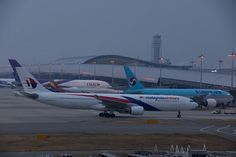 Malaysia Airlines Airbus A330-323E (registered 9M-MTM) taxiing at Osaka (KIX/RJBB)