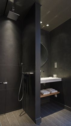 Shower with Black Tiles