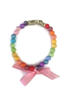 Jesus, Holy Bible, Rainbow, God's Promise, Christian Jewelry, Faith, Flower Beads, Gold Letter Beads, Pink Ribbon, Bow Tie by WomenAfterGodsHeart on Etsy