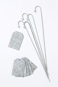 """Galvanized Plant Markers, $38 for 6 tags and stakes, anthropolgie.com    Ob-freakin-sessed.    And, because I know you're wondering, """"label with paint, marker, or to use again, with chalk""""."""