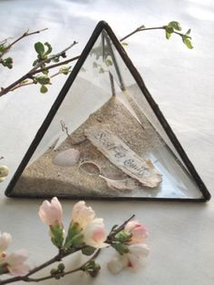 The perfect wedding gift, this prism contains two sterling silver wedding bands, pheasant feathers, white stones, driftwood... and birch bark with the bride and groom's name hand calligraphed on one side, their wedding date on the other.