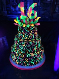 Glow in the dark cake -  This cake glows under a blacklight. We used edible Disco Dust with piping gel to get this effect. Valerie for Cakes Sake - New Orleans La