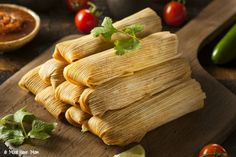 If you love authentic Mexican food then this authentic corn tamales recipe will be right up your alley! Did you know you can make them yourself and you don't need to dine out at the local Mexican joint
