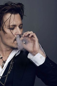smoking is disgusting to me and yet this is hot ????? Johnny Depp is a sorcerer