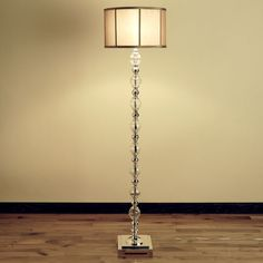 Polished metal and glass floor lamp.