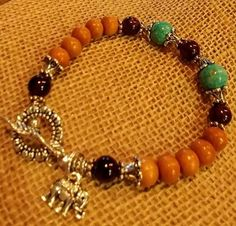 Aromatic Sandalwood Meditation/Prayer Mala Beads with GARNET and MAGNESITE and the lucky Elephant charm.  PM MiChielle Cooper on Facebook for purchase info.