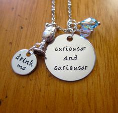 """Disney's Alice in Wonderland Inspired Necklace. """"Curiouser and Curiouser"""" with a """"drink me"""" charm and 2 Swarovski Crystals. By WithLoveFromOC, $23.00"""