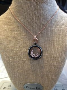 Features our Rose gold ball station chain, rose gold clasp, large black living locket with crystals and rose gold love window plate.