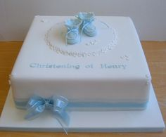 Blue booties christening cake.