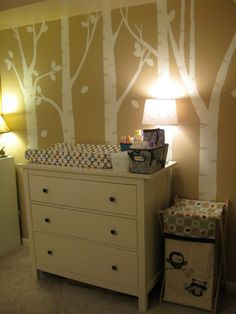 Hand painted tree mural and Ikea dresser as changing table
