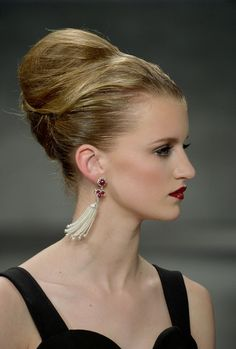 A model walks the runway at the B. Michael America fashion show during Mercedes-Benz Fashion Week Fall 2014