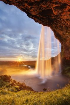 Seljalandsfoss in Iceland. See more of the waterfall here: This is looks...UNREAL!  :))