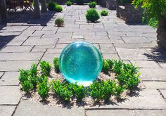 Aqualens Sphere Fountain set in the ground at Yeo Valley Organic Gardens.