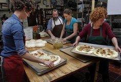 Kitchen workers prepare focaccia bread for the evening dinner, at Esalen Institute in Big Sur, Calif., on Tuesday September 11, 2012. The Institute is celebrating it's 50th anniversary this year. Photo: Michael Macor, The Chronicle / SF