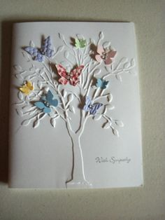 Use tree die cut mounted on white card or emboss using wooden tree as embossing plate