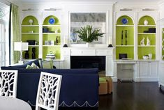 I love the pop of bright green in the back of these bookcases! Plus, Navy,  white and green might be my favorite color combo.