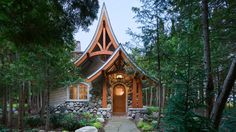 This fairy tale cottage was modified from our storybook cabin plan. Tucked into the woods just off the shore of Lake Michigan, it's used as a pottery studio. Photography by Roger Wade.