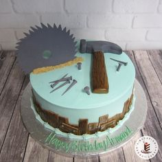 """It is almost the weekend!  Get those """"honey do"""" lists ready... #honeydo #fondanttools  A round buttercream style cake with fondant tools.  A saw, hammer, nails and wood trim make a fun cake for the do-it-yourself personality! #woodsaw"""