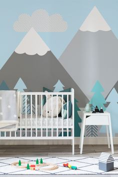 Stylish nursery spaces done easy with one of our mountain wallpapers. Dreamy pastel blue and mint shades help to create a calming environment for your little one. Perfect for modern nursery and playroom spaces.