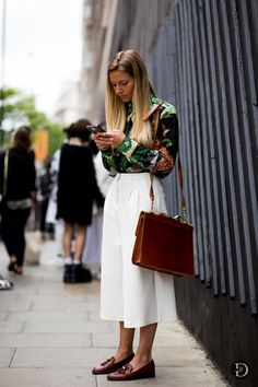 Vintage inspired. Green printed shirt, white culotte pants, tan loafers. Street style