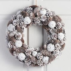 Frosty Pinecone Wreath - Natural Fiber by World Market in Home & Garden, Kitchen, Dining & Bar, Linens & TextilesA plethora of pinecones in every size and style gives our frosty wreath its natural appeal. Finished in glittering white and fitted with Pine Cone Art, Pine Cone Crafts, Pine Cones, Pine Cone Wreath, Pine Cone Christmas Decorations, Christmas Wreaths, Christmas Crafts, Holiday Decor, Xmas