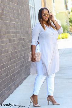 An elegant Tunic with long Slits with Skinny Jeans and Stilletoes