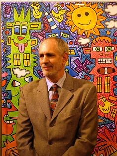 This is an image of James Rizzi and his art.  The official website for his work is jamesrizzi.com