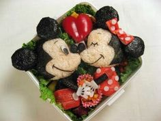 Aawww... They're so cute I want to eat them. Wait, I can! Mickey and Minnie Mouse, made entirely from food. :)