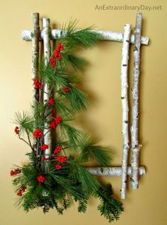 Birch Wreath: Take a unique route with a square-shaped wreath. Put it together with branches, evergreen cuttings, and berries. Find more fresh, tulle, rustic, deco mesh, burlap, natural, grapevine and ornament filled DIY Christmas wreaths ideas for your front door and indoors that are easy to make here.