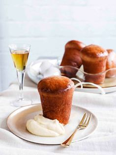 Rum baba with orange cream. A classic from Naples, Italy
