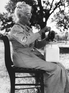 An old woman churning butter. Photograph by George W. Ackerman. Stephens County, Oklahoma, USA, July 1935.
