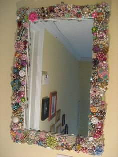 "A fun project to work on over time with your daughter: Look for different costume  jewelry and pins at yard sales and ""redecorate"" a plain mirror."