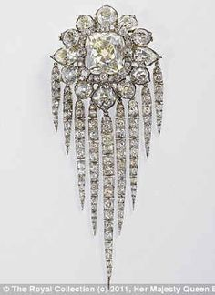 Queen Victoria's Fringe Brooch will be on public display for the first time during the exhibition. The brooch was made by R. Garrard & Co. for Queen Victoria in and features a large emerald cut central stone surrounded by small diamonds. Royal Crown Jewels, Royal Crowns, Royal Jewelry, Tiaras And Crowns, Fine Jewelry, British Crown Jewels, Royal Tiaras, Bling Bling, Antique Jewelry