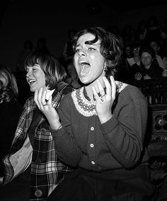 A screaming fan watches the band perform on stage at Carnegie Hall, New York, 1964