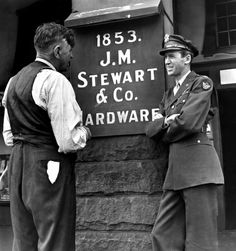 Jimmy Stewart and his father outside the family hardware store in 1945 upon his homecoming.