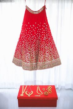 Red and golden bridal lehenga by sabyasachi with bridal jewellery | weddingz.in | India's Largest Wedding Company | Wedding Venues, Vendors and Inspiration | Indian Wedding Bridal Jewellery Ideas |