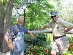 A pair of our very own conductors of the model railroad garden.