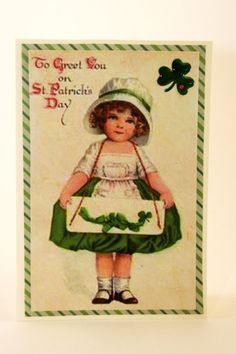 This vintage St. Patrick's Day card features an Ellen Clapsaddle image and is just too sweet. This wee Irish lassie and her shamrocks on green striped paper can be found at our shop:  CatieGraceCreations.etsy.com