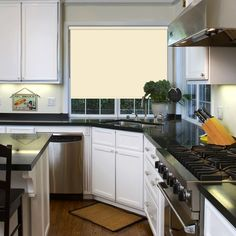 A Cream Pvc Roller Blind Which Is Custom Made And Perfect For Kitchens Bathrooms
