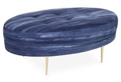 The ombre indigo upholstery on this glamorous cocktail ottoman is so unique!